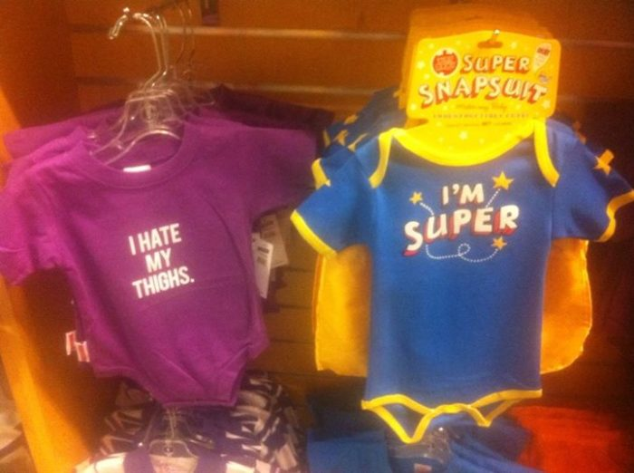 "picture of girl's onsie that says ""I hate my thighs"" and a boy's onsie that says ""i'm super"""